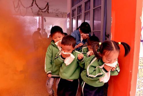 مانور آتش سوزی در کودکستانی در شهر دکسین در شرق چین